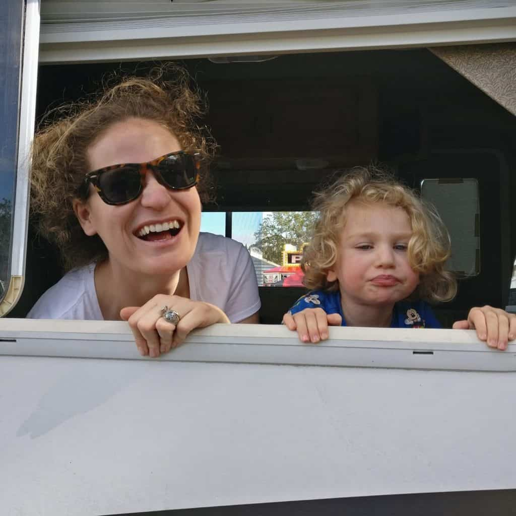 Mom and daughter playing in the RV, laughing and smiling, getting along