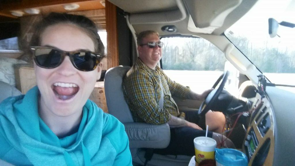 ed and liz wilcox take a selfie of their rv family travel in class c motorhome