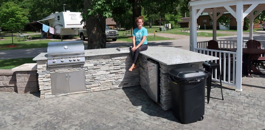 Liz Wilcox sits on awesome outdoor kitchen at an RV resort in Port Huron, Michigan.