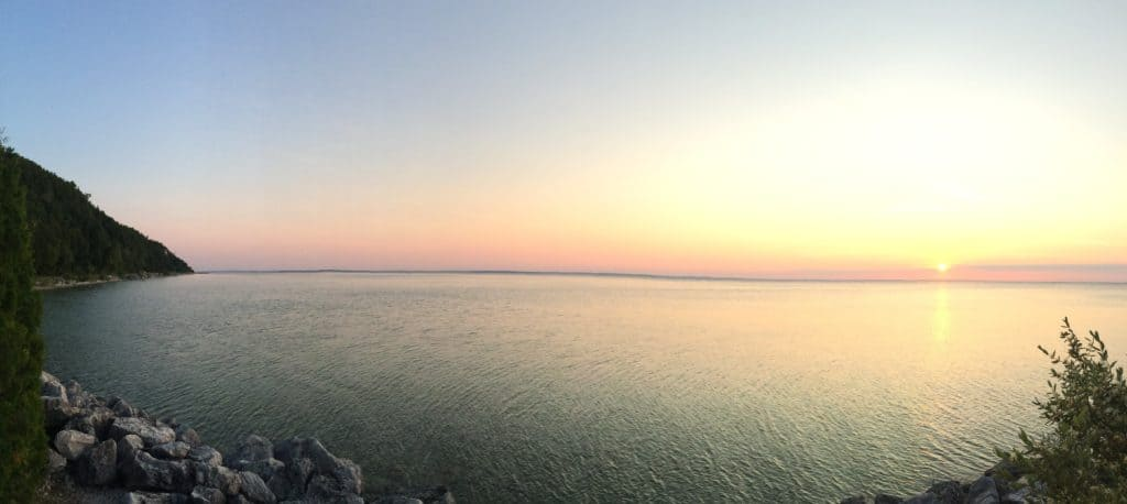 picture of sunset over Lake Huron at Mackinac Island while visiting on an RV vacation in the summer