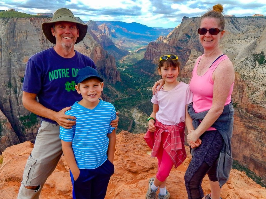the Roving Foleys, family of 4 at the Grand Canyon smiling