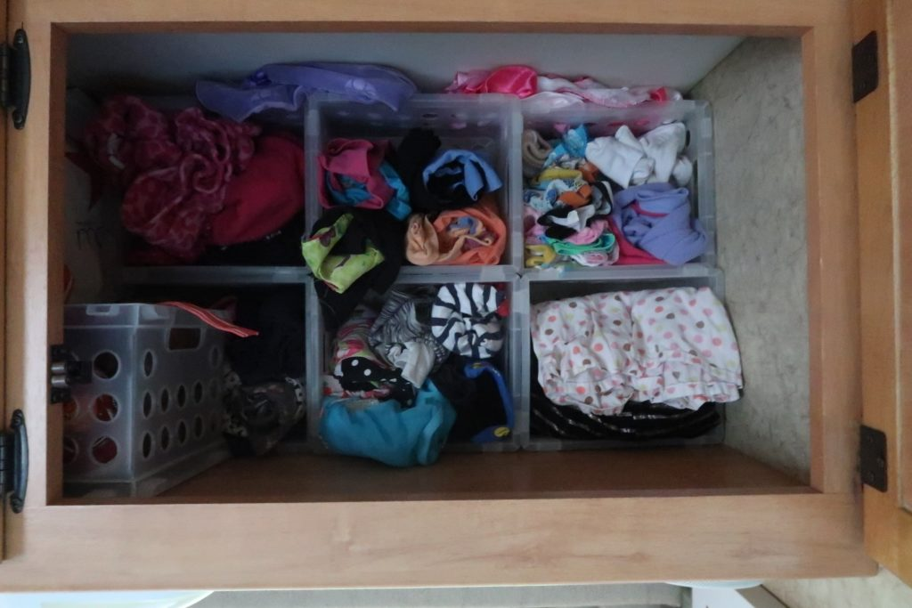 Picture of RV organization idea of putting shelves in a large cabinet to make a closet for kid clothes
