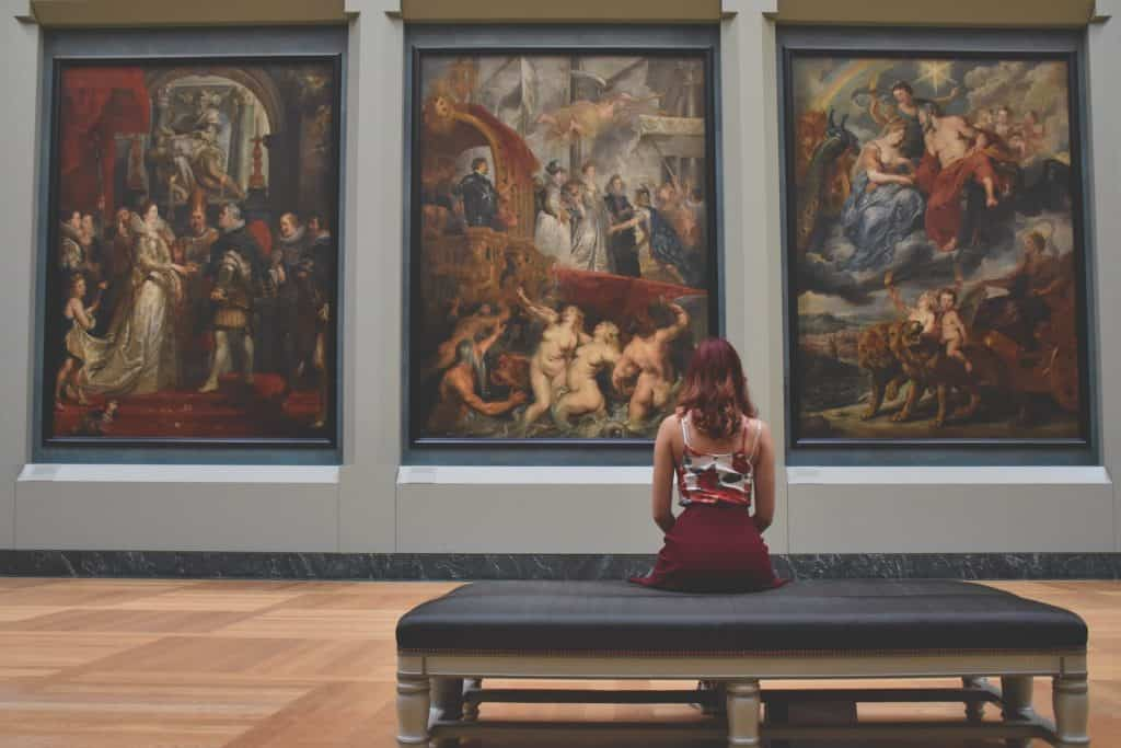 girl looks at large paintings in cleveland, ohio