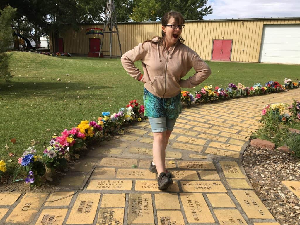 girl on yellow brick road at museum in Liberal, KS